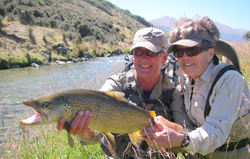 Fly fishing New Zealand - Happy Fly fisher with big trout