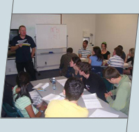 classroom of defensive driving students